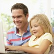 Father And Daughter Using Laptop At Home — Stock Photo #4823842