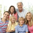 Extended Family Relaxing At Home Together — Stock Photo