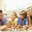 Family Playing Board Game At Home — Stock Photo #4823868