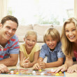 Family Playing Board Game At Home — Stock Photo #4823869