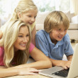 Mother And Children Using Laptop At Home — Stock Photo