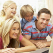 Family Using Laptop At Home Together — Stock fotografie #4823887