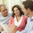 Stock Photo: Senior Couple With Financial Advisor At Home