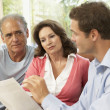 Senior Couple With Financial Advisor At Home — Stock Photo