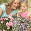 Woman With Daughter Gardening Together - Stock Photo