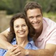 Senior Woman Being Hugged By Adult Son — Stock Photo