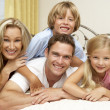 Family Relaxing On Bed At Home — Stock Photo