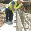 Construction Worker Laying Foundations — Stock Photo #4823986