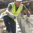 Construction Worker Laying Foundations - Stockfoto