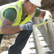 Construction Worker Laying Foundations — Stock Photo #4823990