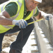Construction Worker Laying Foundations — Stock Photo #4823991