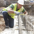 Construction Worker Laying Foundations — Stock Photo