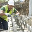 Construction Worker Laying Foundations — Stock Photo #4823997