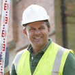 Construction Worker Holding Measure — Stock Photo #4824022