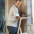 Plasterer Working On Interior Wall - Stock Photo