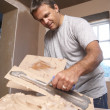 Plasterer Mixing Plaster - Stock Photo