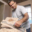 Stock Photo: Plasterer Mixing Plaster