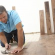 Builder Laying Wooden Flooring — Stock Photo