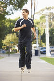 Young Man Jogging On Street — Foto Stock