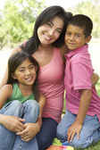 Mother And Children In Park — Stock Photo