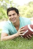 Portrait Of Young Man In Park With American Football — Stock Photo