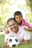 Grandfather With Grandson In Park With Football — Stock Photo
