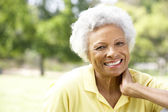 Portrait Of Smiling Senior Woman Outdoors — Stock Photo