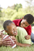 Grandfather With Grandson In Park With American Football — Stock Photo