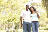 Portrait Of Young Couple Walking In Park — Stock Photo