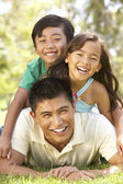 Father And Children Enjoying Day In Park — Stock Photo