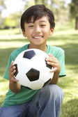 Portrait Of Young Boy In Park With Football — Stock Photo
