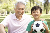Grandfather And grandson In Park With Football — Stock Photo