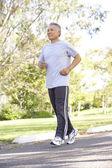 Middelste leeftijd man joggen — Stockfoto