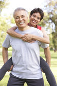 Senior Couple Working Out In Park — Stok fotoğraf