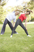 Senior Couple Exercising In Park — Foto Stock