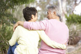 Back View Of Senior Couple In Park — Stock Photo