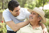 Senior Man With Adult Son In Garden — Stock Photo