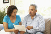 Senior Couple Studying Financial Document At Home — Foto Stock