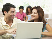 Parents Using Laptop At Home — Stock Photo