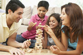 Family Playing Game Together At Home — Stock Photo
