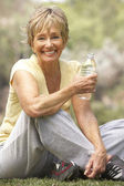 Senior Woman Relaxing After Exercise — Stock Photo