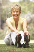 Senior Woman Exercising In Park — Stock fotografie