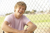Teenage Boy Sitting In Playground — Stock Photo