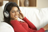 Young Woman Listening To Music At Home — Stock Photo