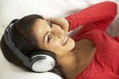 Young Woman Listening To Music At Home — Foto Stock
