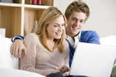 Young Couple Using Laptop At Home — Foto Stock