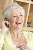 Senior Woman Using Phone At Home — Stock Photo