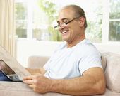 Senior Man Reading Newspaper At Home — Stock Photo
