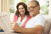 Senior Couple Reading Newspaper At Home — Foto Stock