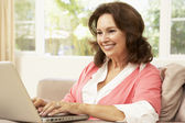 Senior Woman Using Laptop At Home — Stock Photo